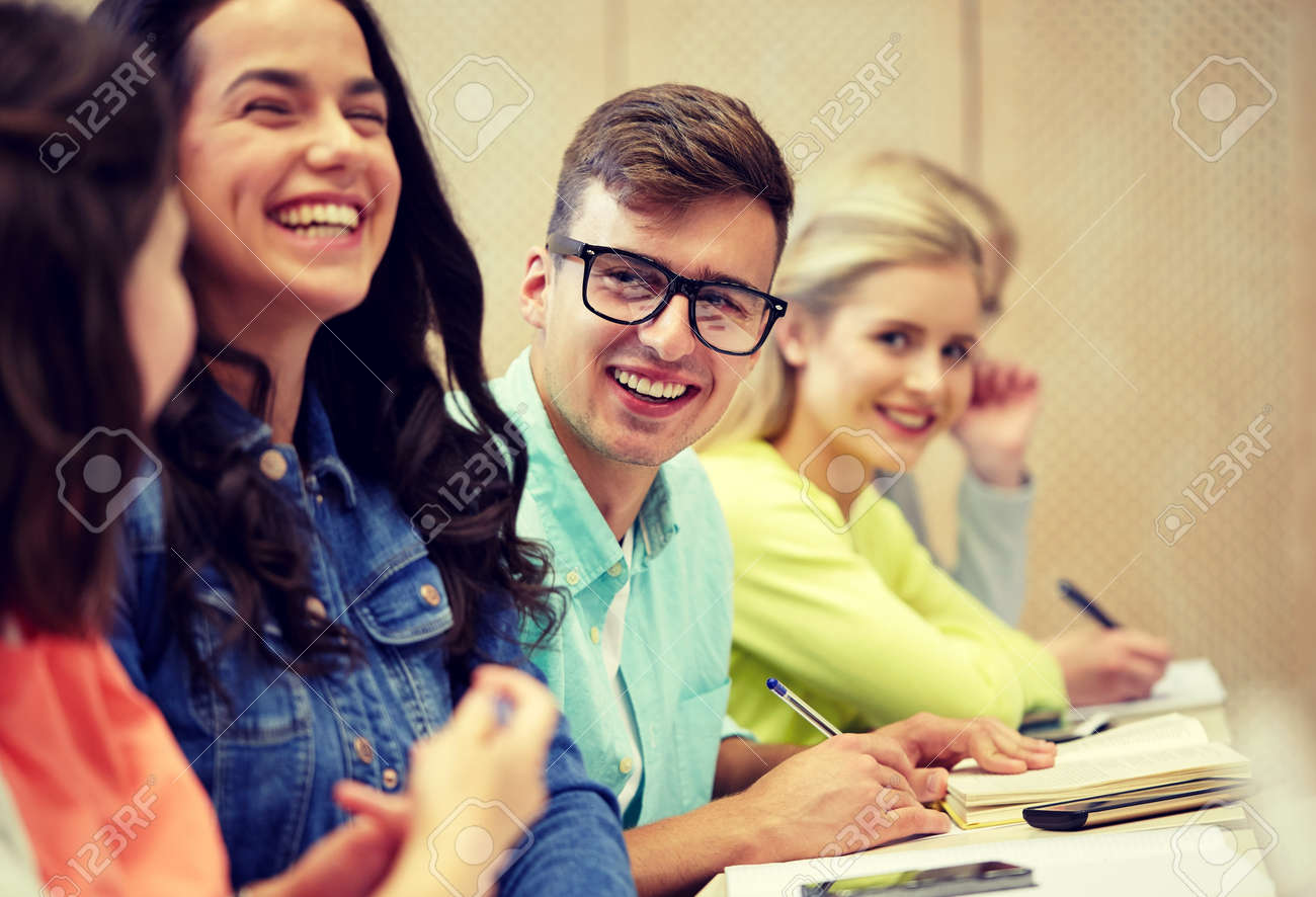 education, high school, university, vision and people concept - young man in eyeglasses with group of students at lecture - 120267752