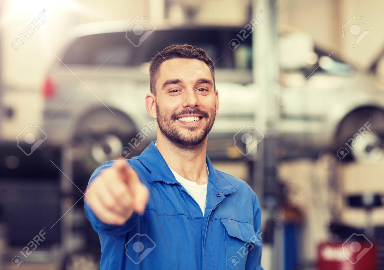 happy auto mechanic man or smith at car workshop - 120497504