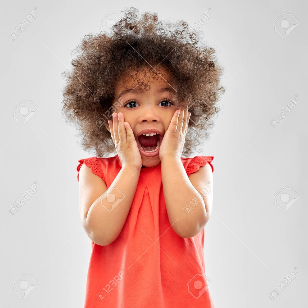 Surprised or scared little African American girl - 120571412
