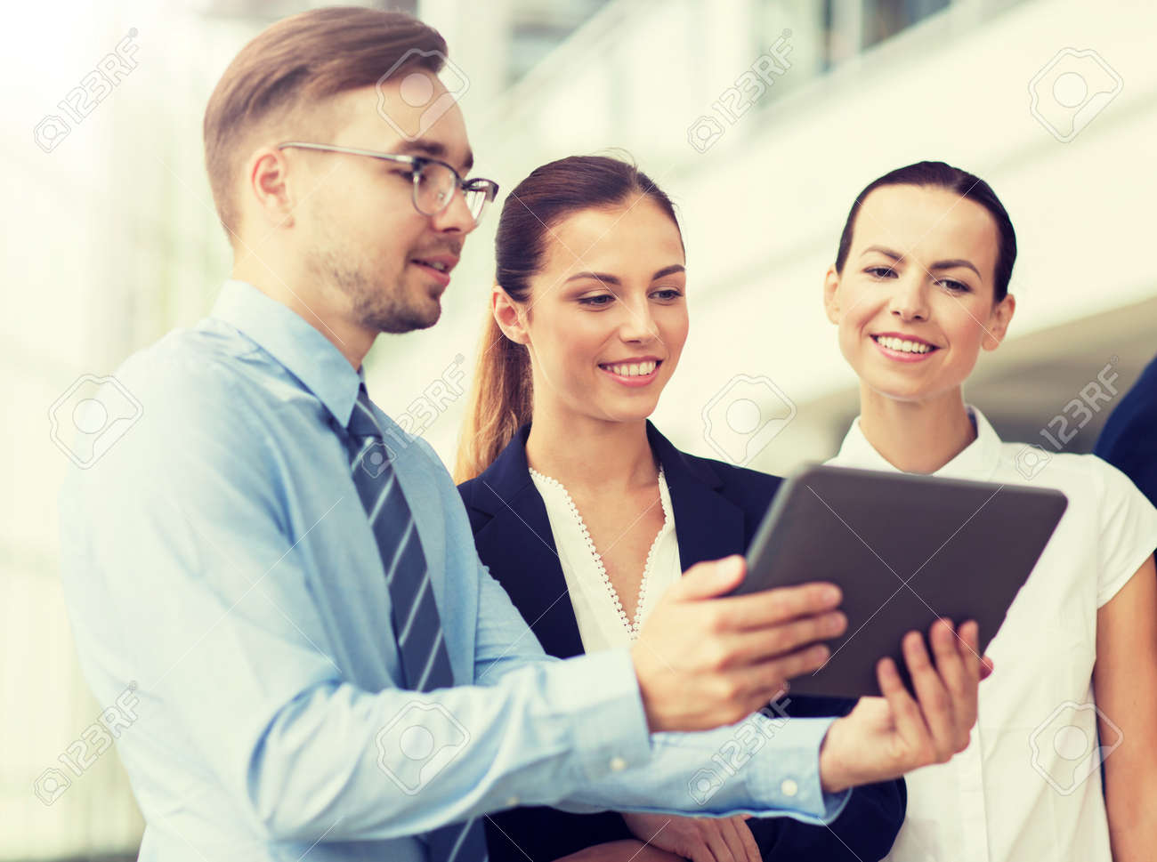 People, technology, work and corporate concept - Business team with tablet pc computer at office - 120892750