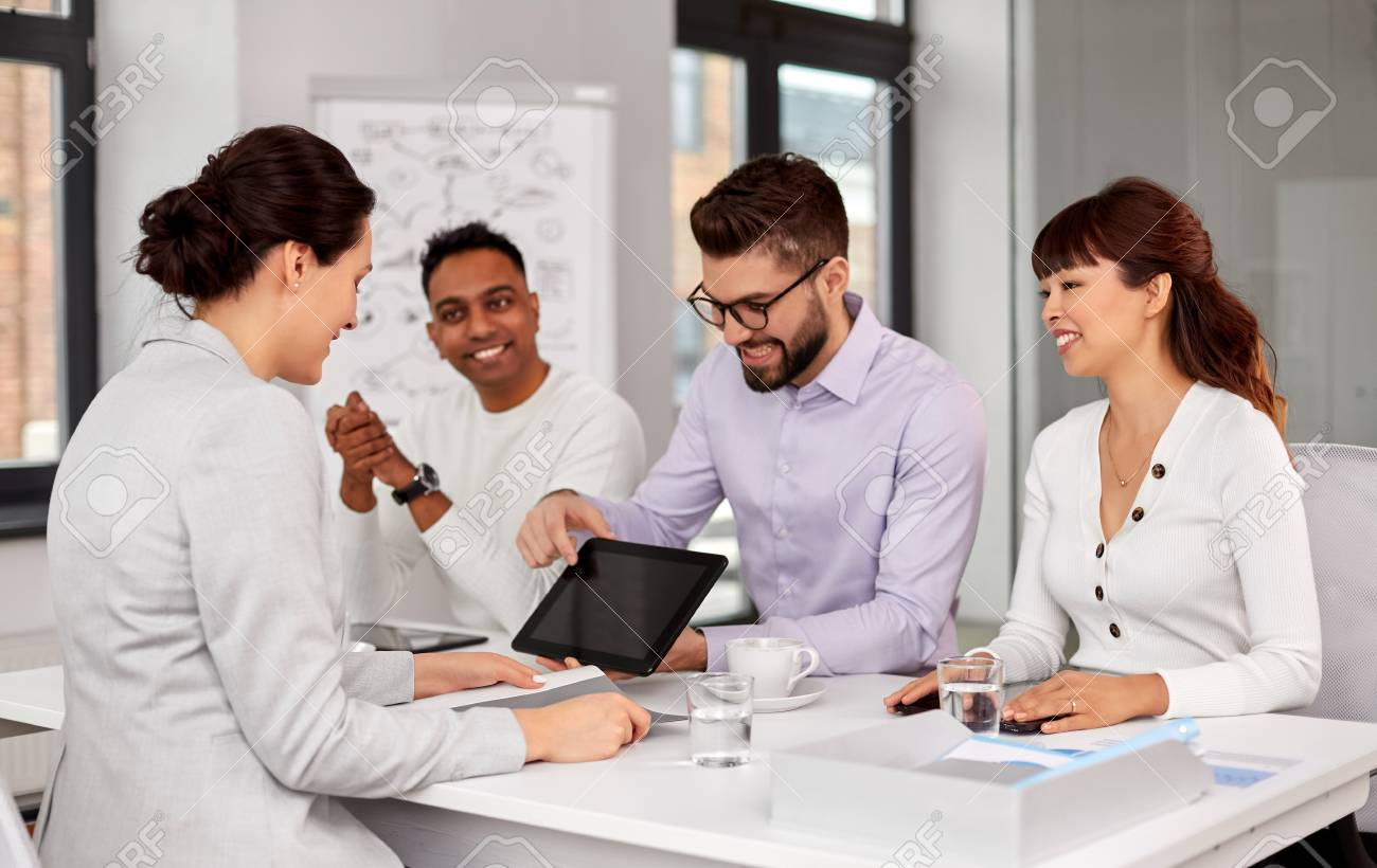 team of recruiters with tablet pc at job interview - 121618100