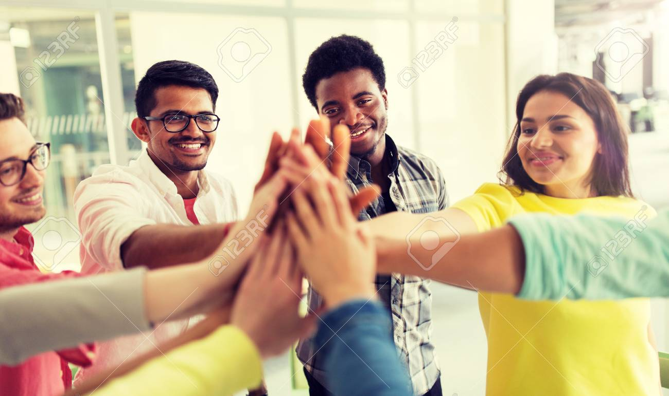 Group of international students making high five - 121996490