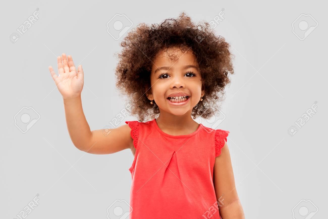 happy little african american girl waving hand - 122218769