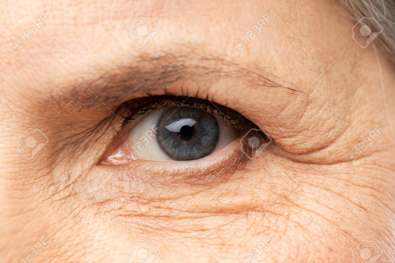 Vision, beauty and old age concept - close up of senior woman eye - 122308245