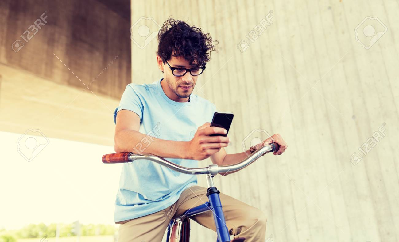 man with smartphone and fixed gear bike on street - 122451828
