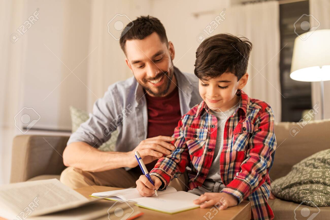 Father and son doing homework together - 122648495