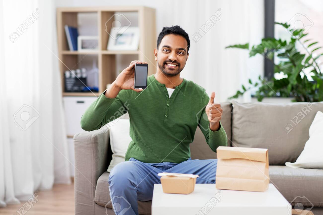 indian man using smartphone for food delivery - 123908455