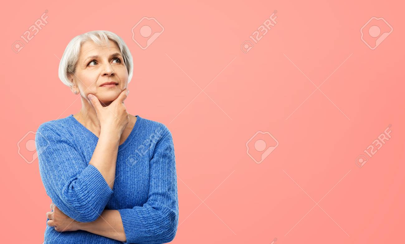 portrait of senior woman in blue sweater thinking - 124766688