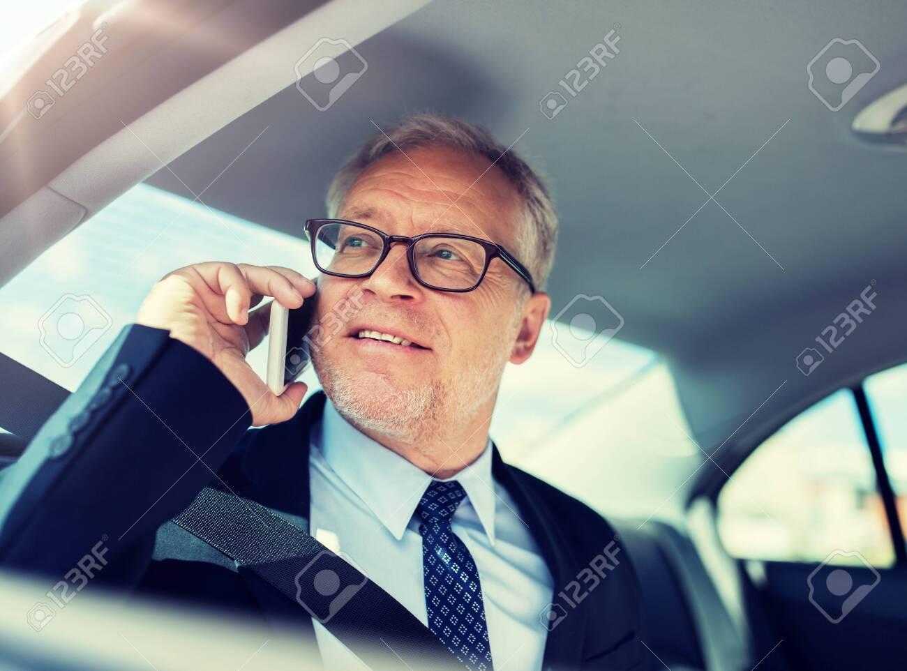 senior businessman calling on smartphone in car - 124309646