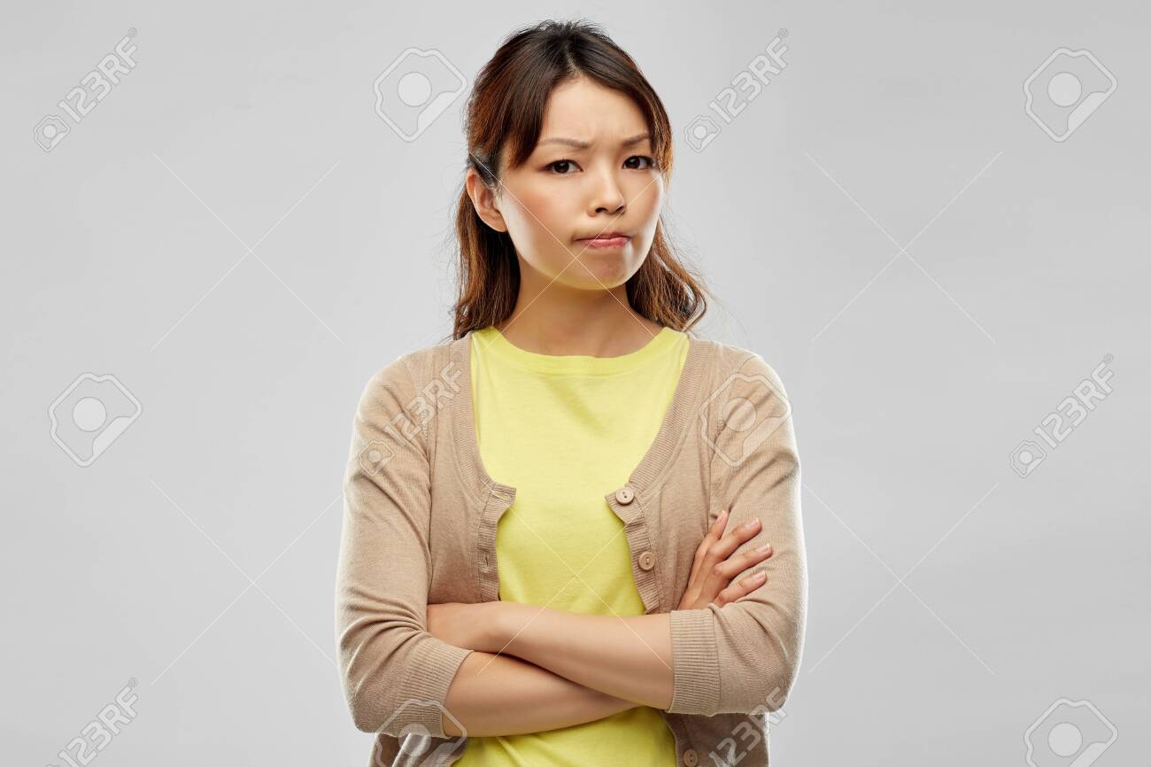 displeased asian woman with crossed arms - 124311052