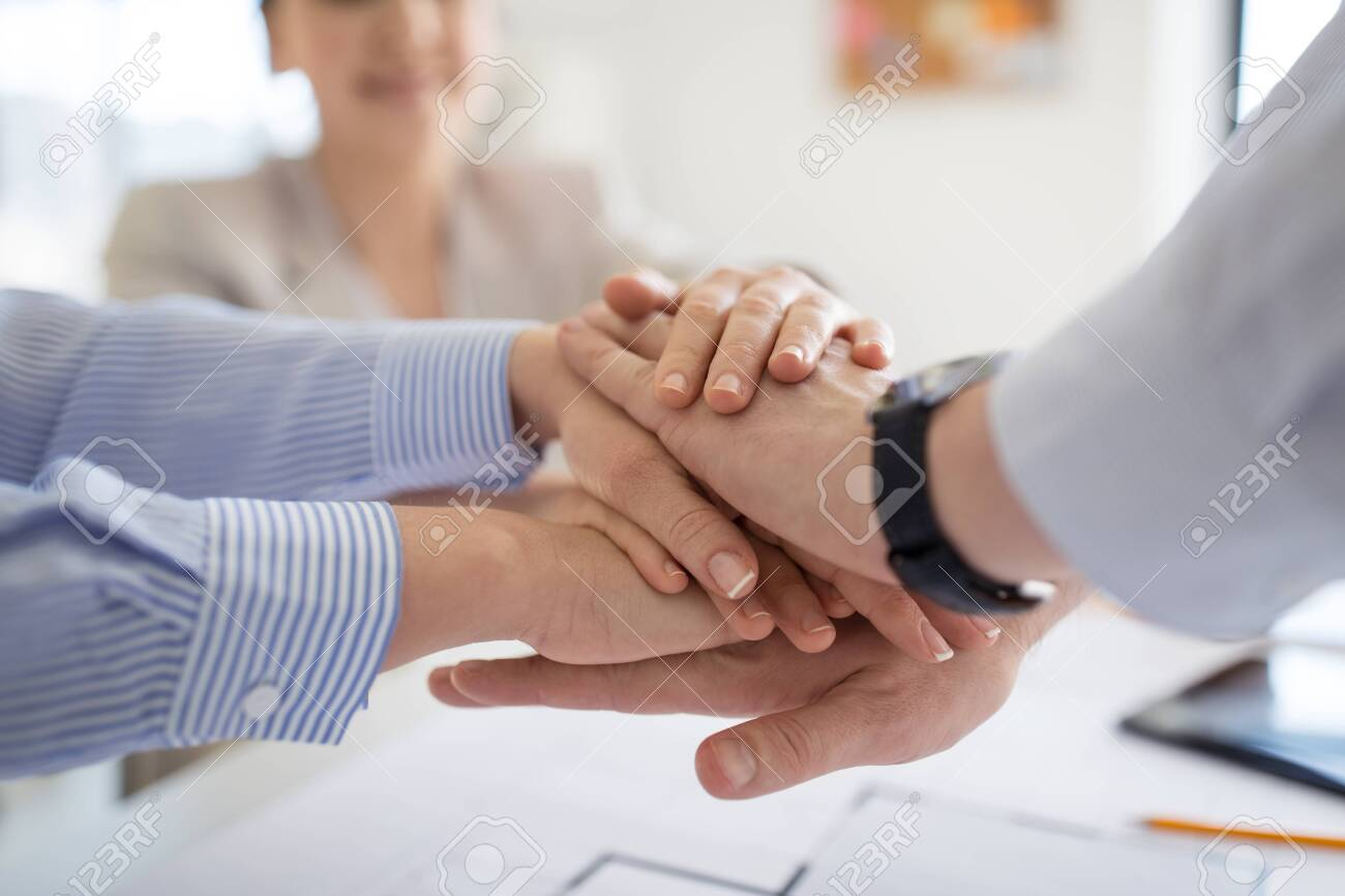 close up of business team stacking hands - 124633844