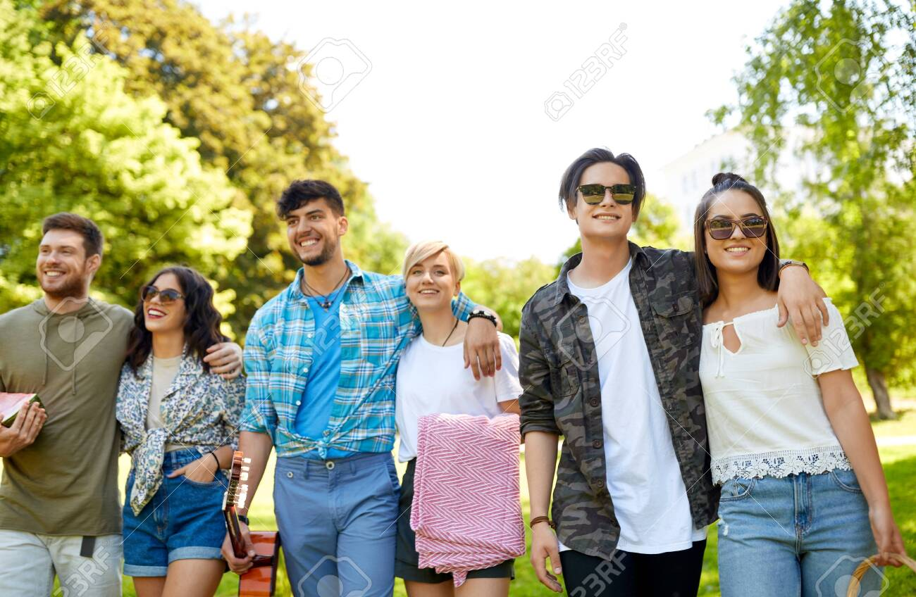 friends with guitar going to picnic at park - 126481326