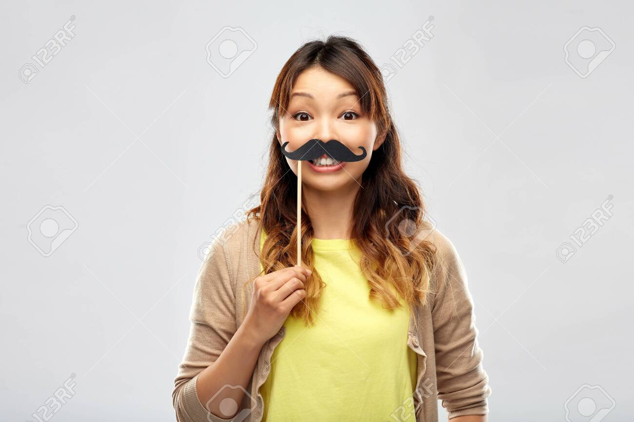 Happy Asian woman with big black mustache - 126774763