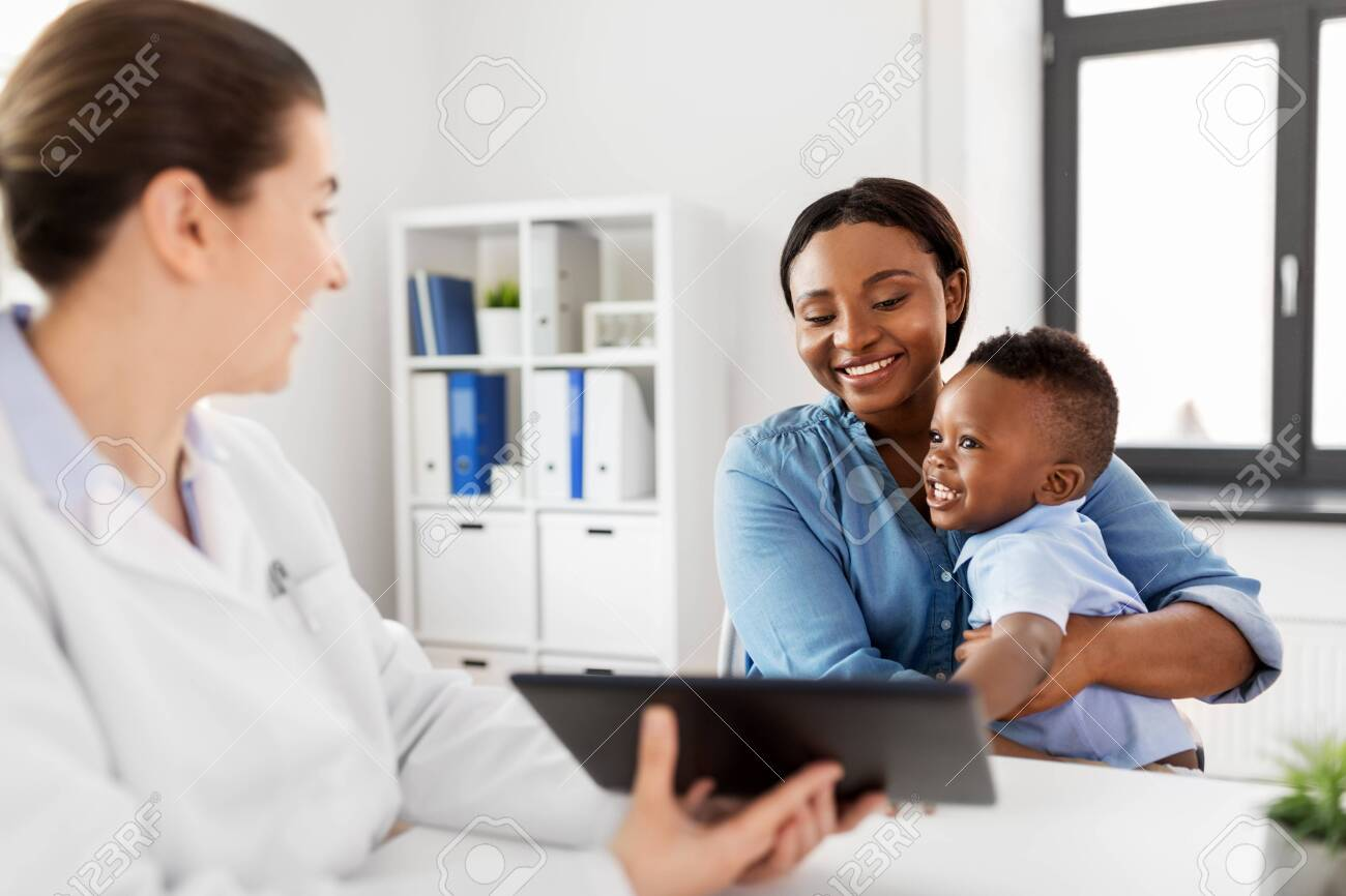 Mother with baby and doctor with tablet at clinic - 126774843