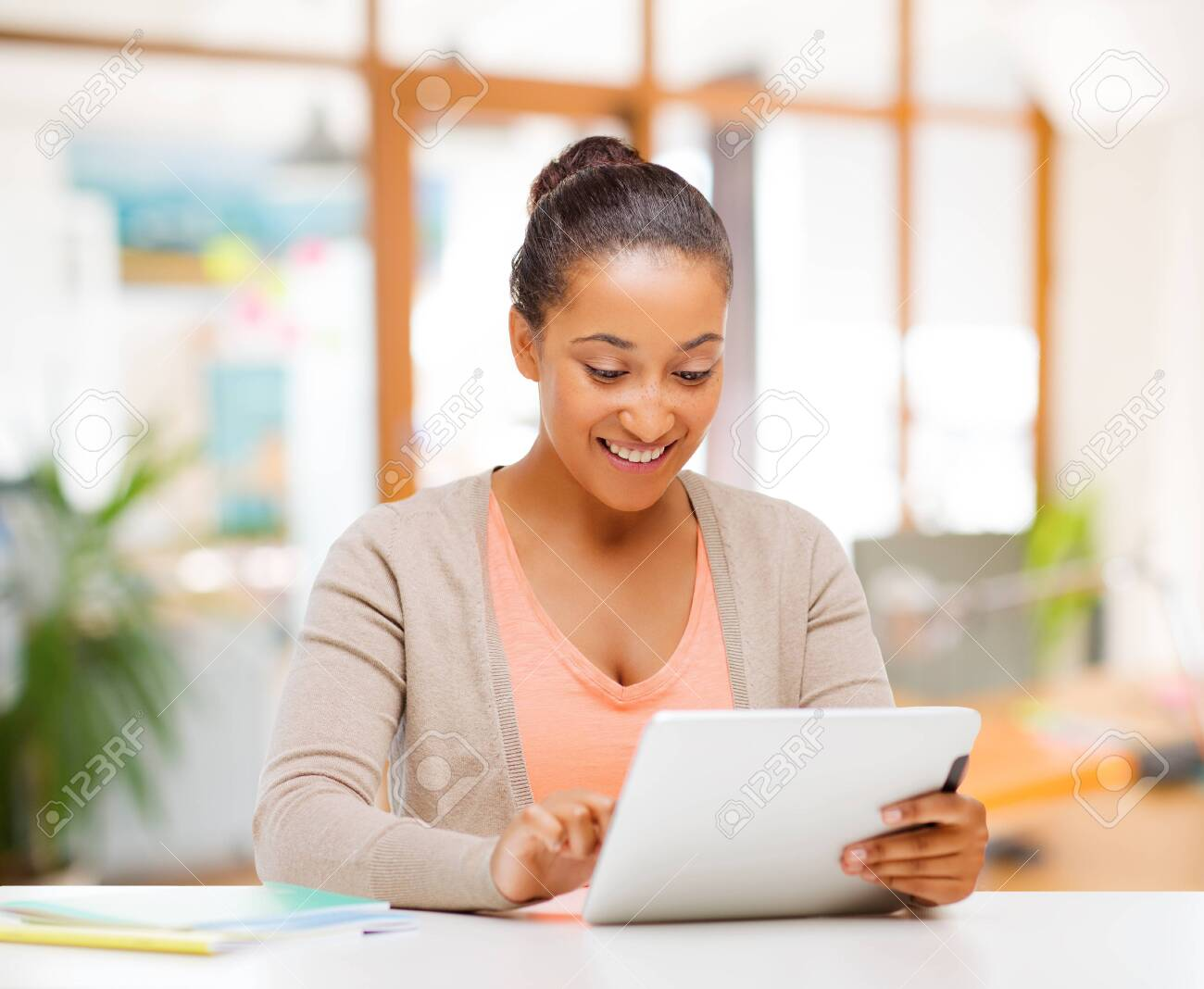african american woman with tablet computer - 127121583