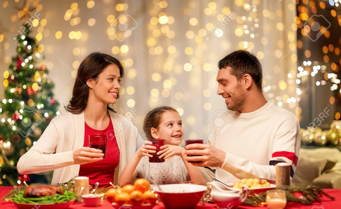 happy family having christmas dinner at home - 130054581