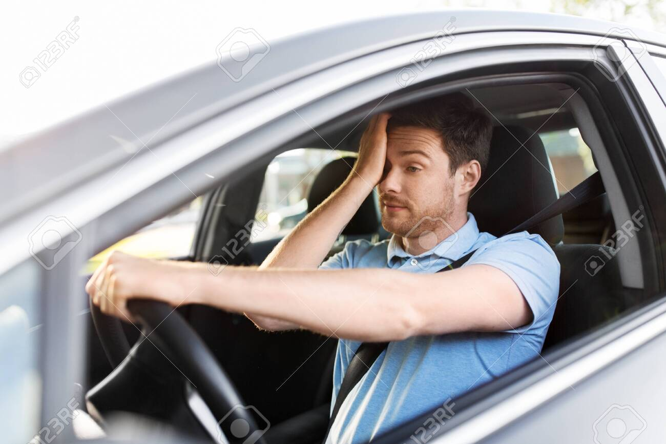 transport, vehicle and driving concept - tired sleepy man or car driver rubbing eyes - 130121148