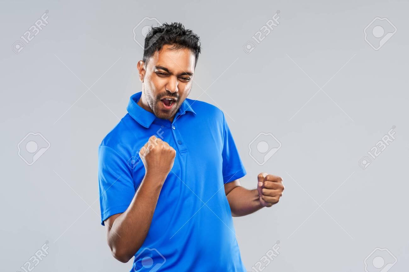 happy indian man celebrating victory - 130497160