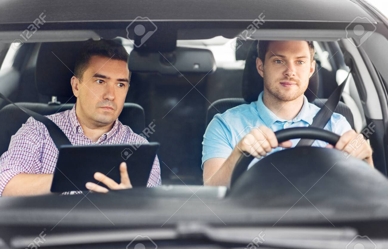Car Driving School Instructor And Young Driver Stock Photo, Picture And  Royalty Free Image. Image 130587138.