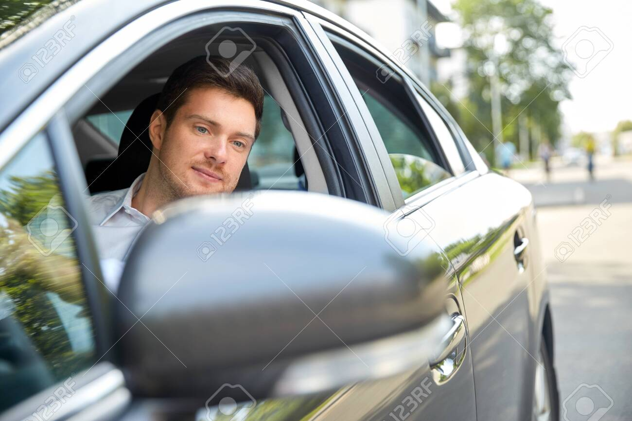 transport, vehicle and people concept - man or driver driving car in summer - 130746019