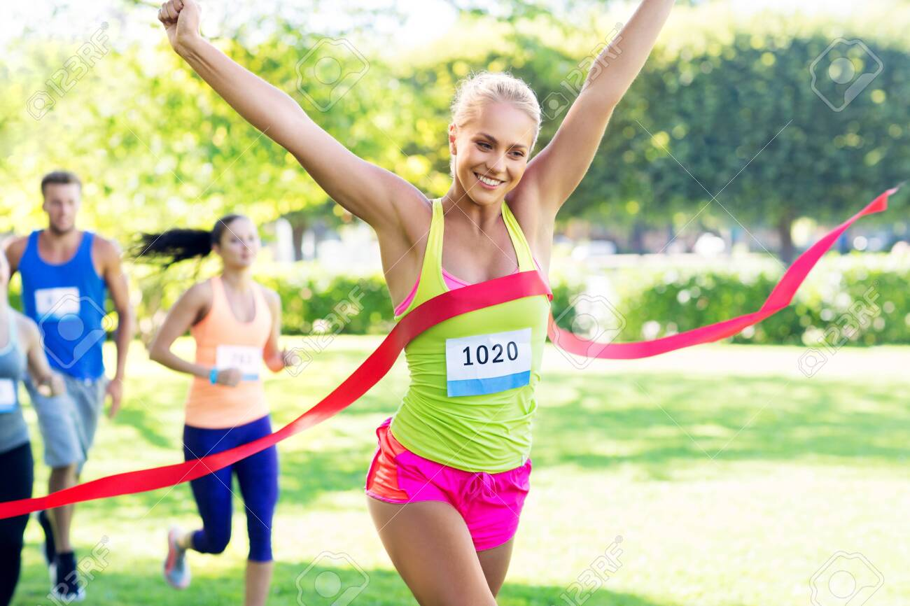 Happy Young Female Runner On Finish Winning Race Stock Photo, Picture And Royalty Free Image. Image 130804610.