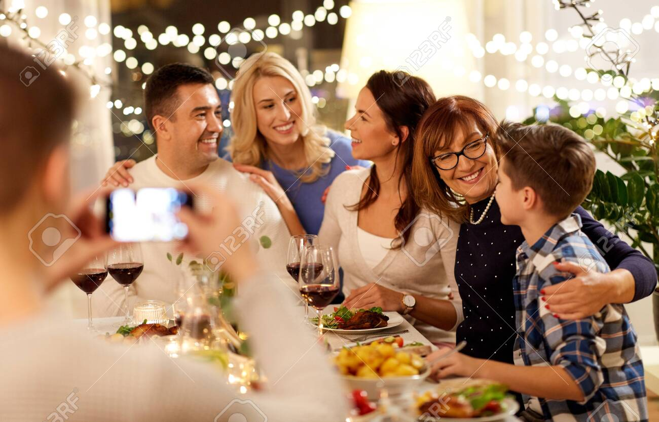 family having dinner party and taking selfie - 131150358