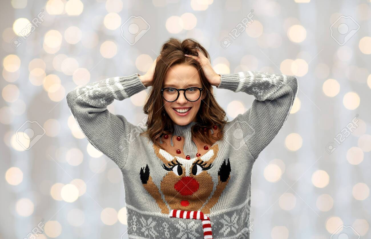 woman in christmas sweater with reindeer pattern - 131460511