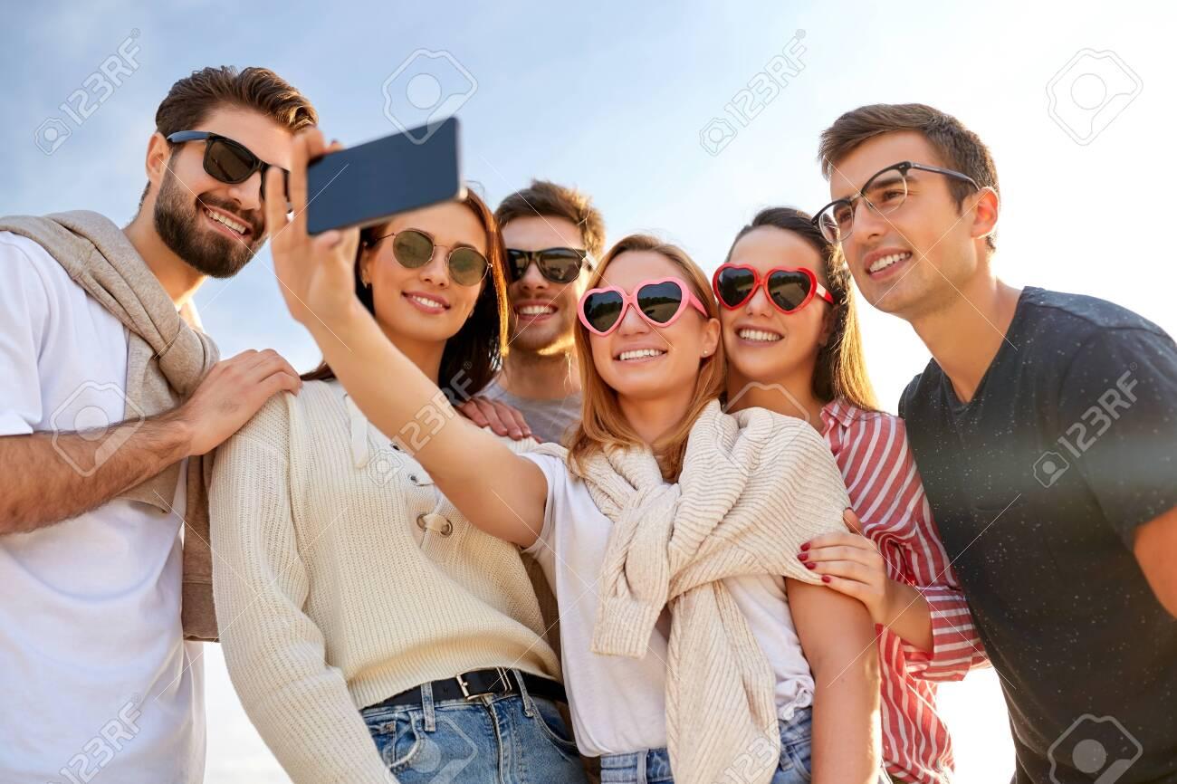 happy friends taking selfie in summer - 131305961