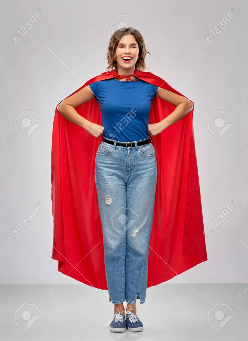 women's power and people concept - happy woman in red superhero cape over grey background - 132997226