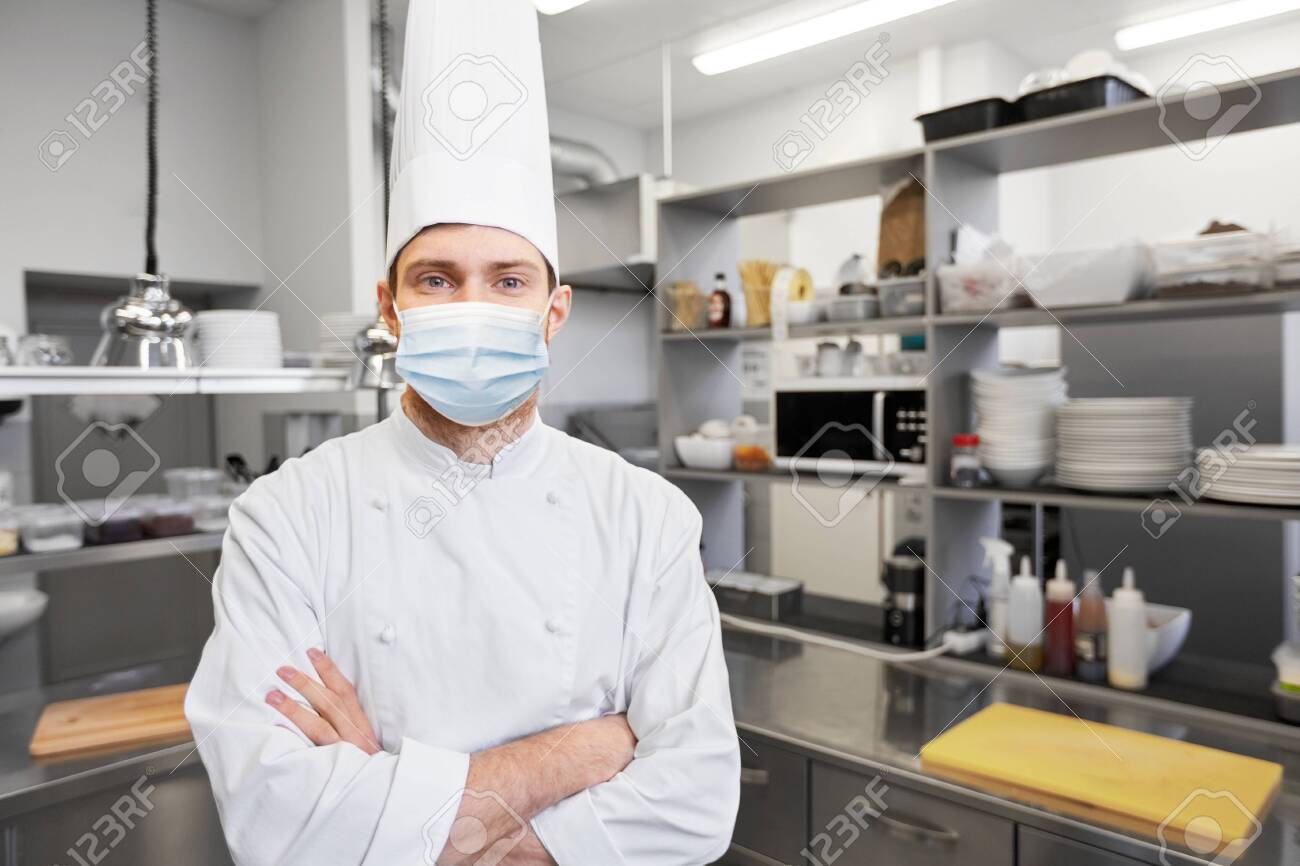 male chef cook in face mask at restaurant kitchen - 144145591