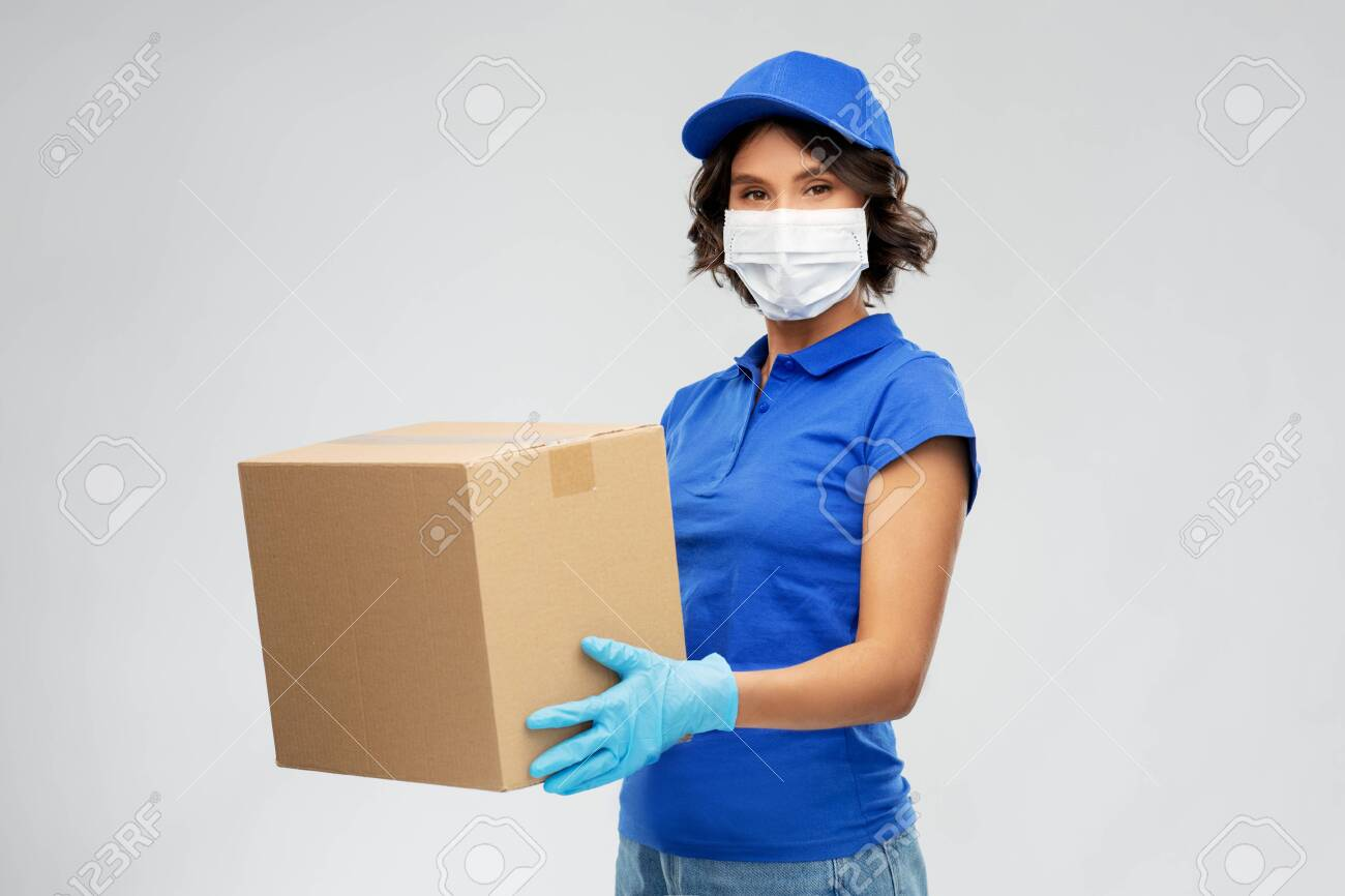 delivery woman in face mask holding parcel box - 144229685