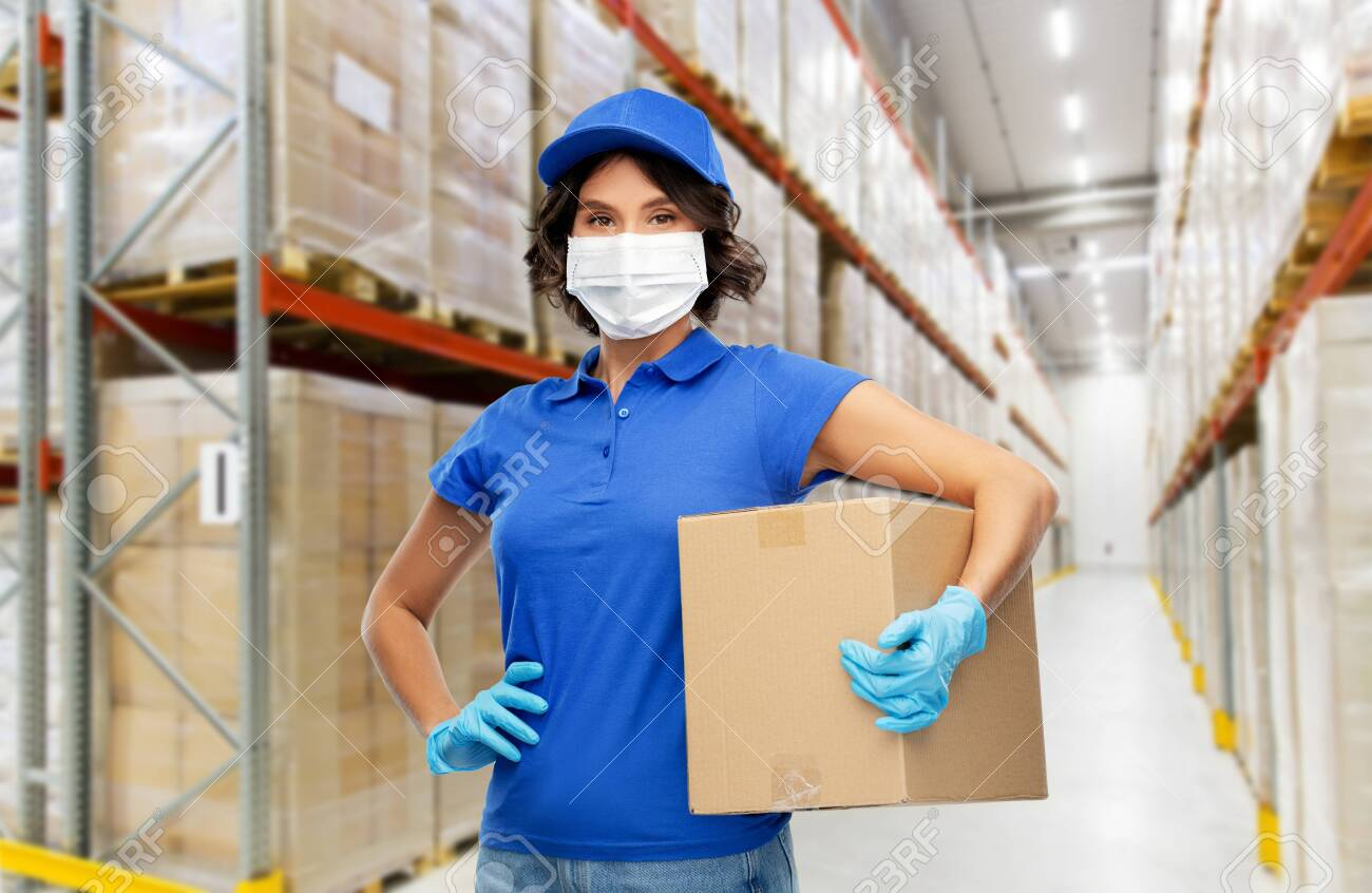 delivery woman in face mask holding parcel box - 145417324
