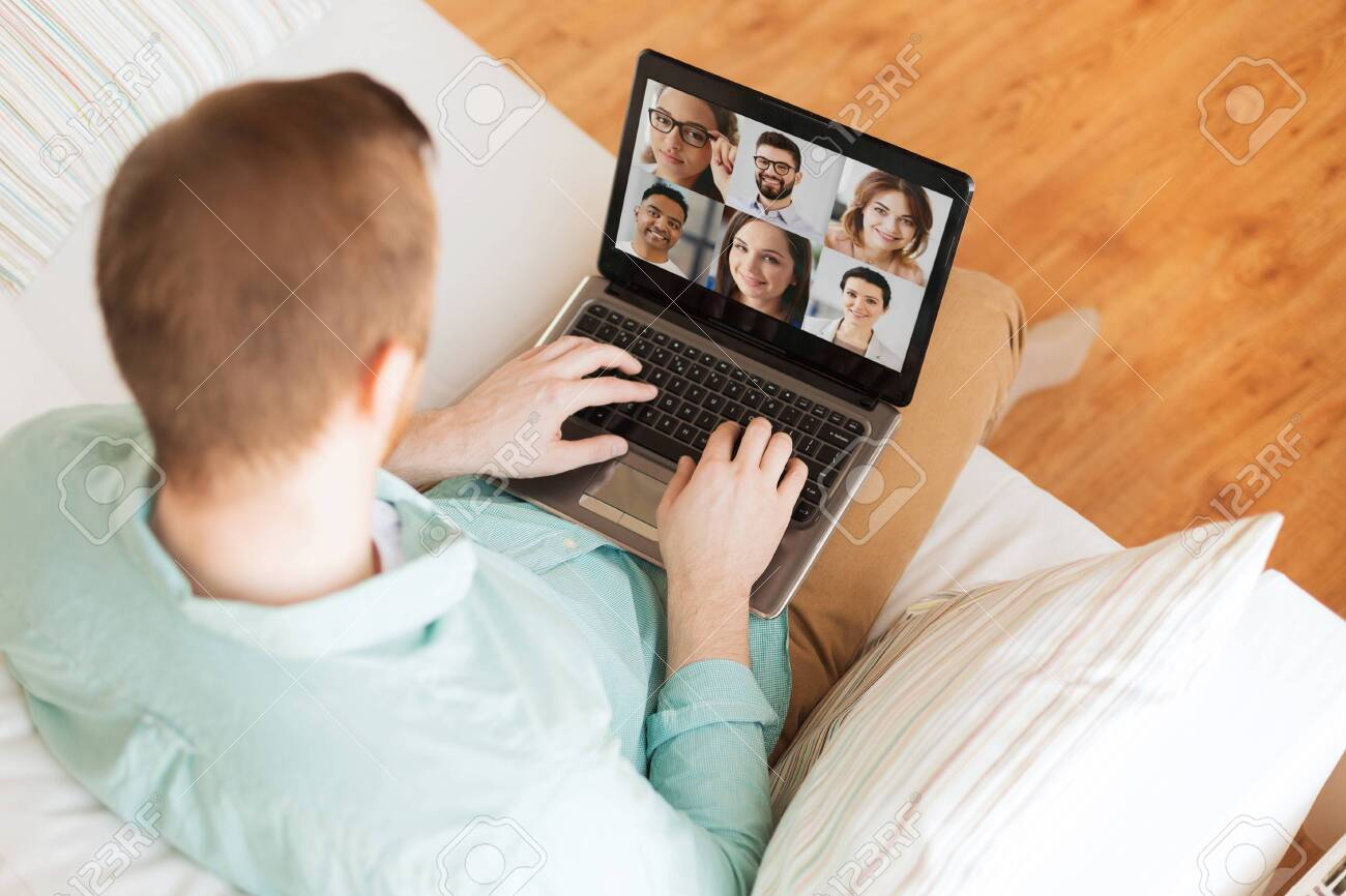 man with laptop having video call with colleagues - 145813219