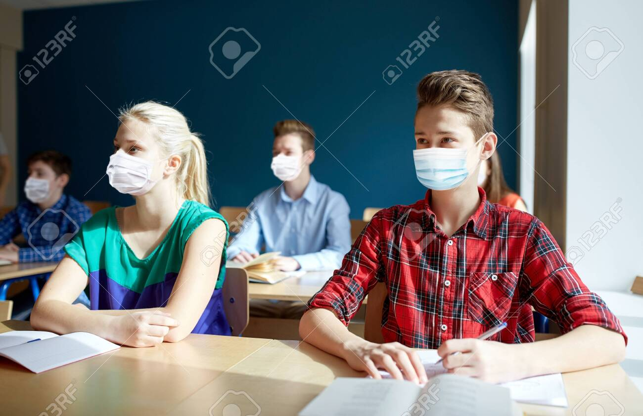group of students in masks at school lesson - 147446135