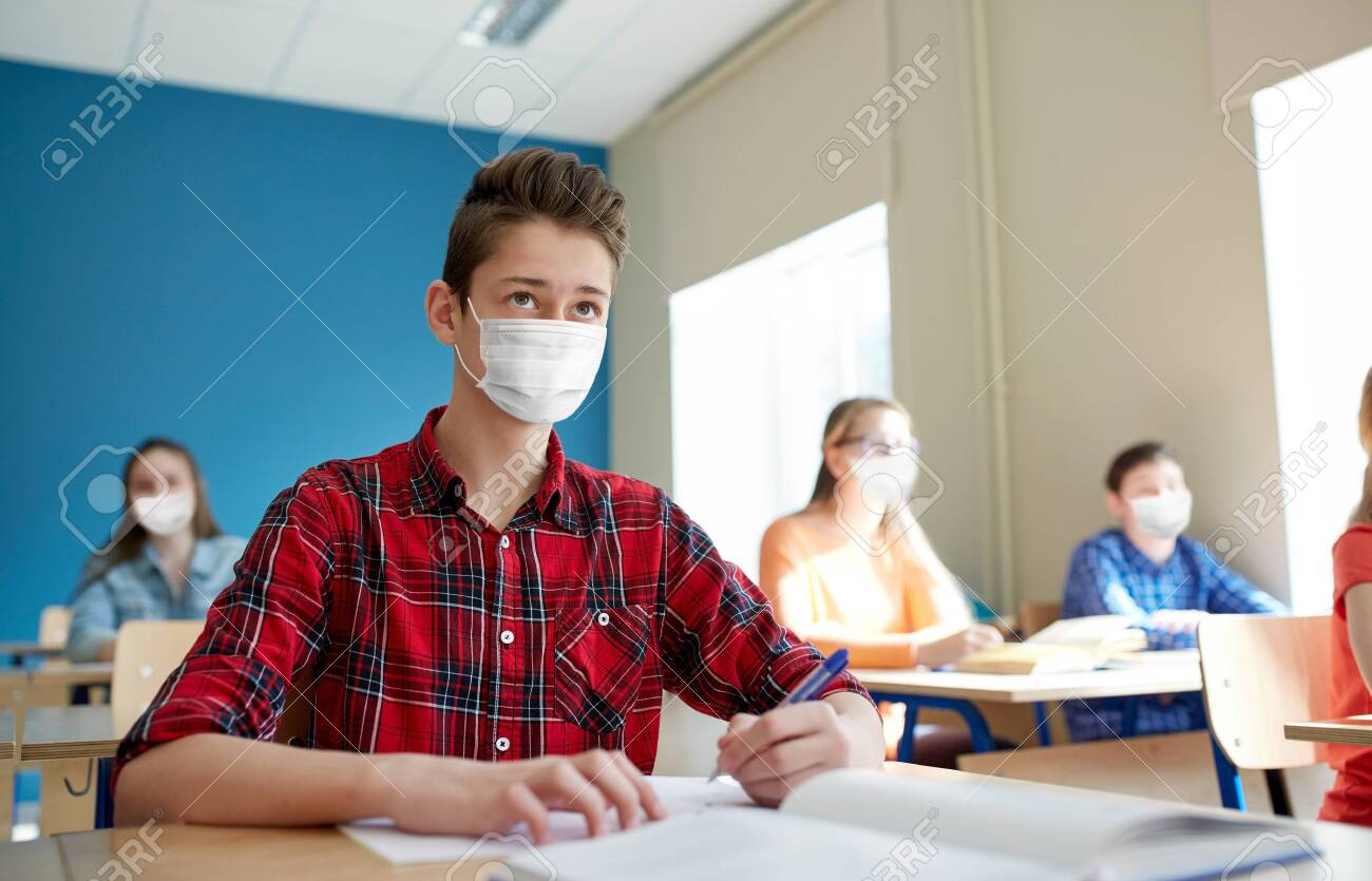 group of students in masks at school lesson - 147446136