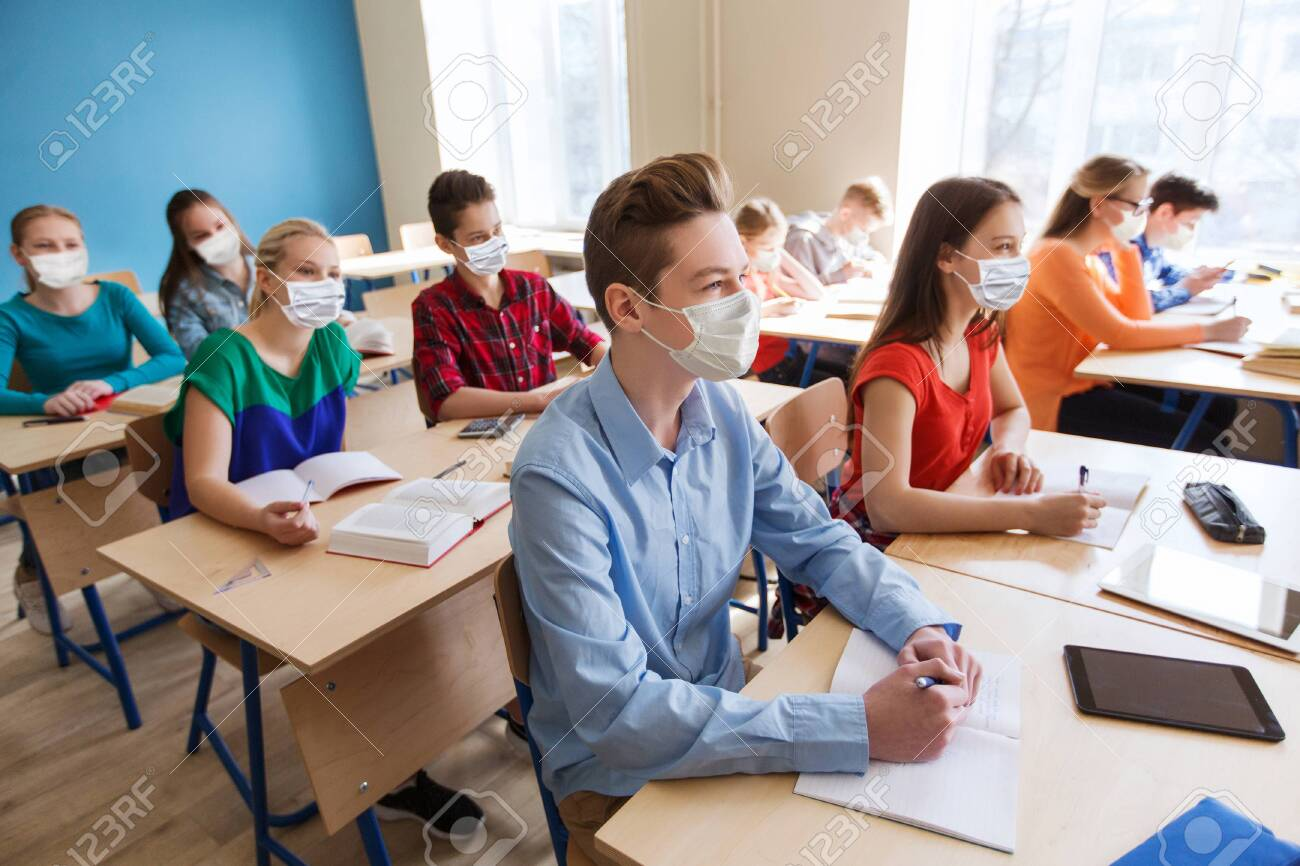group of students in masks at school lesson - 147446137