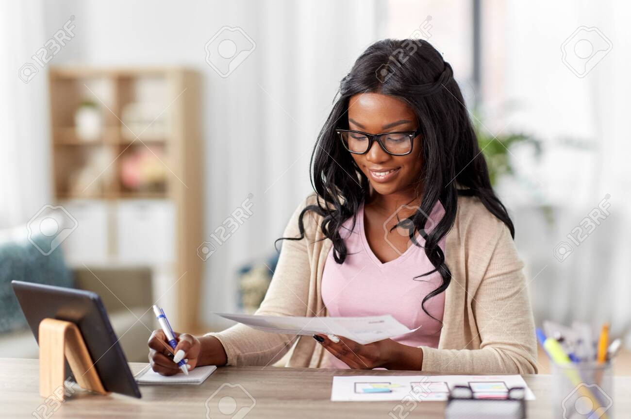 african woman working on ui design at home office - 151435605