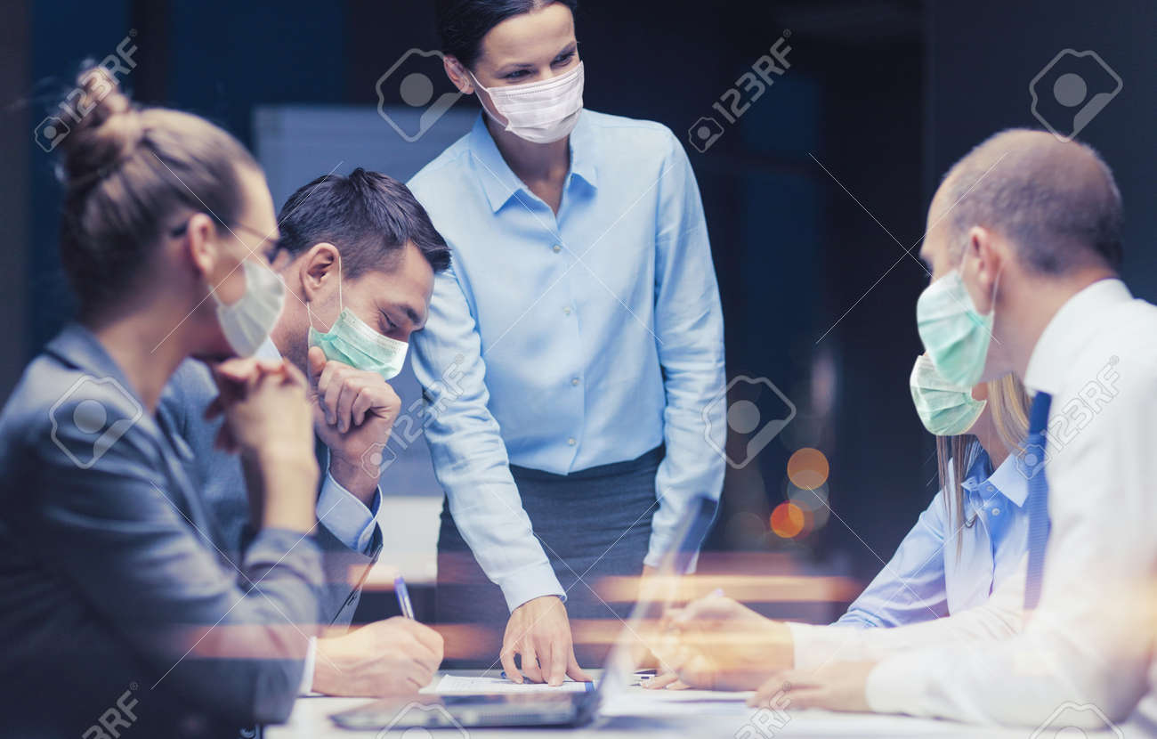 female boss in mask with business team at office - 155251645
