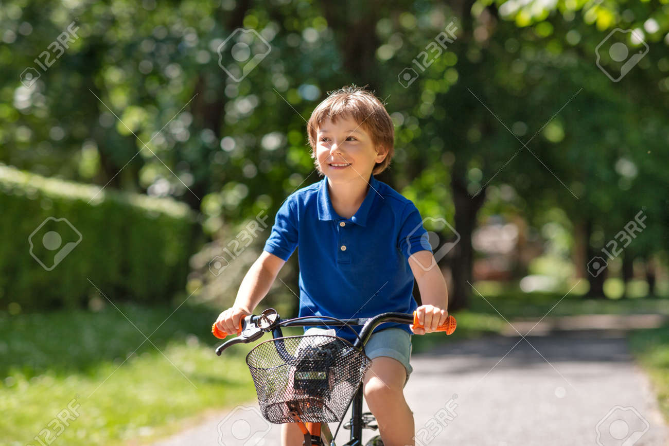 happy little boy riding bicycle at summer park - 155293770