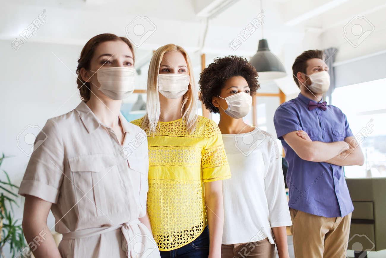business team in masks in office - 156545425