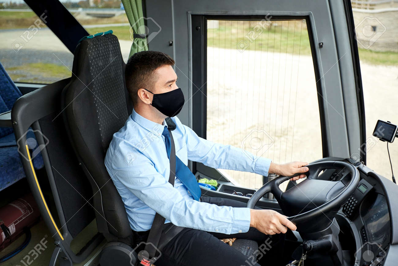 male driver in black mask driving intercity bus - 156802178