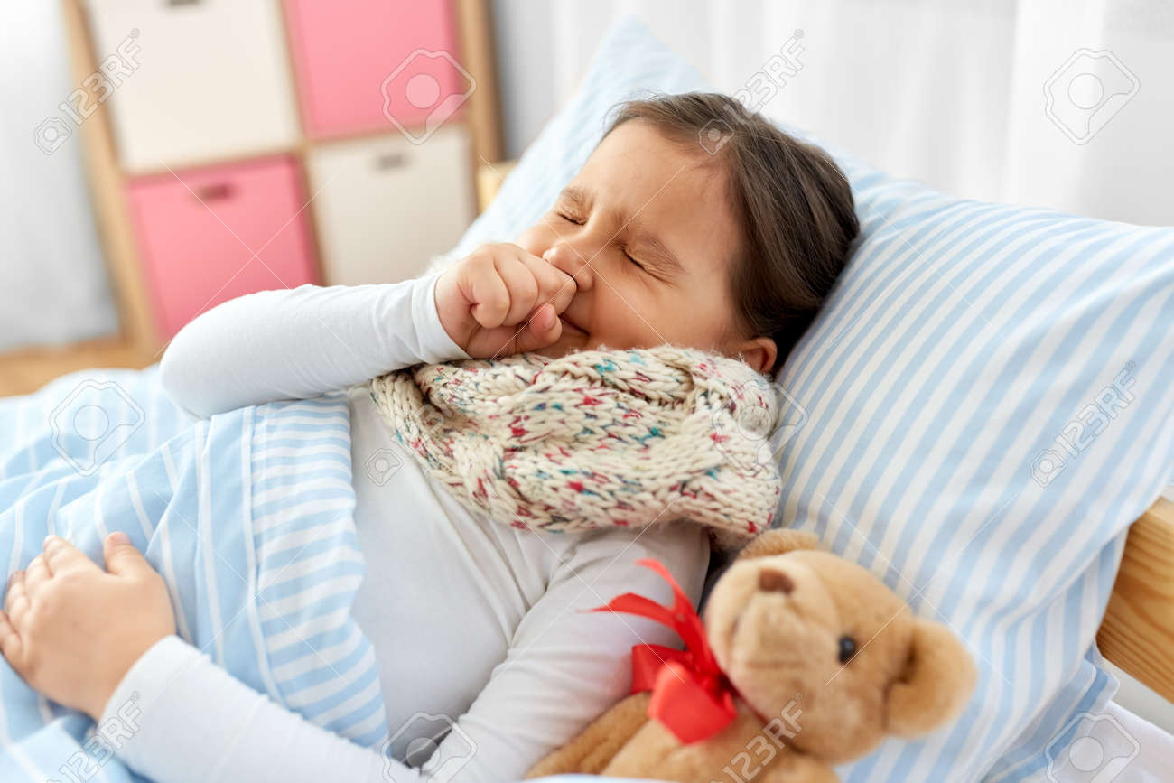 sick coughing girl lying in bed at home - 157865258
