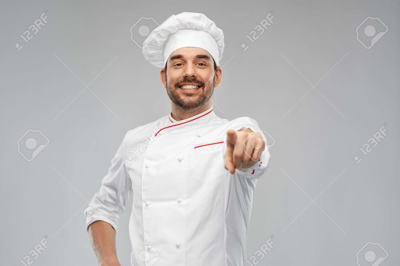 happy smiling male chef in toque pointing to you - 168635520