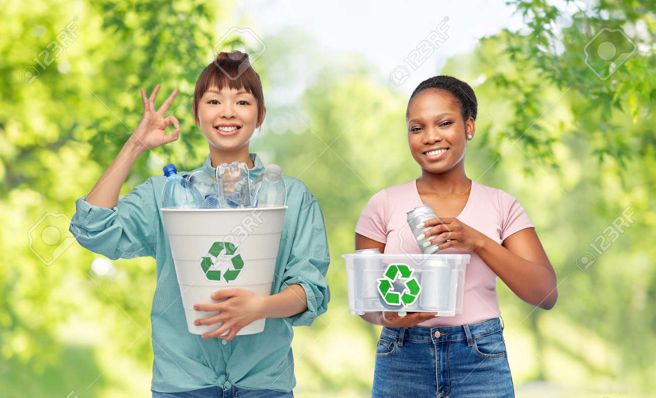 happy women sorting plastic and metallic waste - 169910282