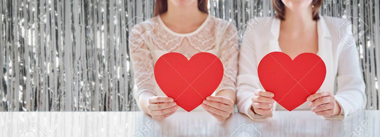 close up of happy couple with red hearts - 169910284