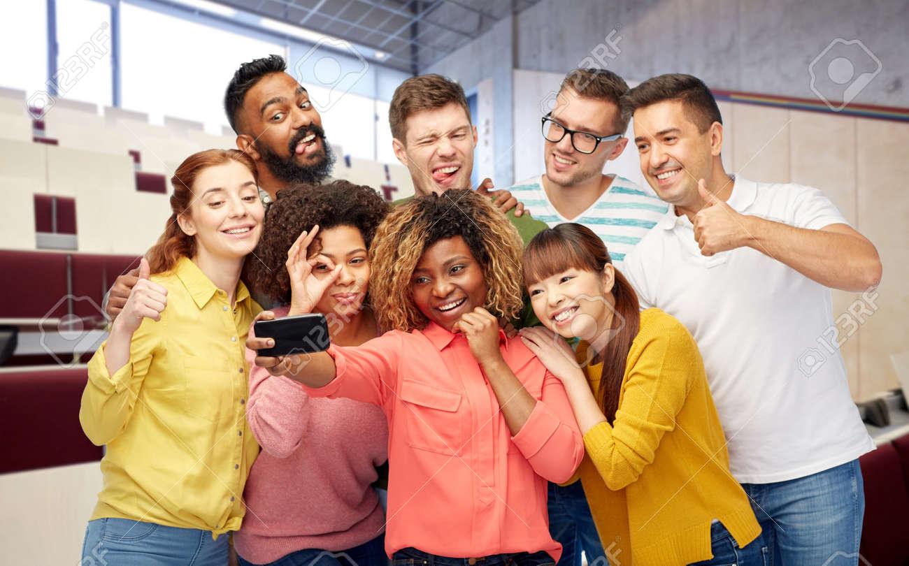 international students and teacher taking selfie - 169910289