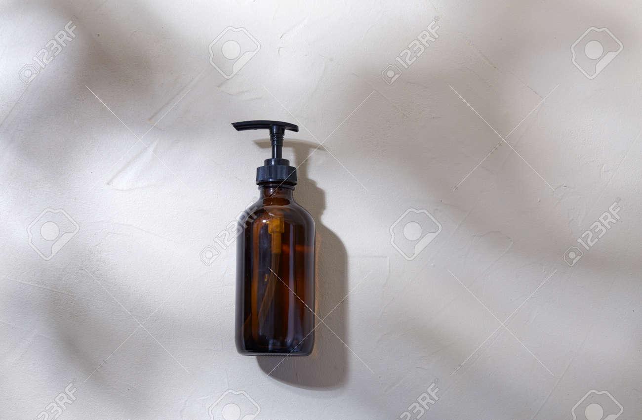 bottle of shower gel or liquid soap with dispenser - 169966308