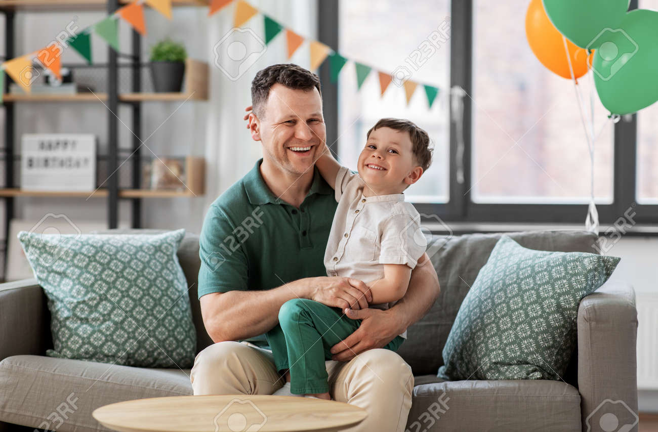 happy father and little son at home birthday party - 169967746