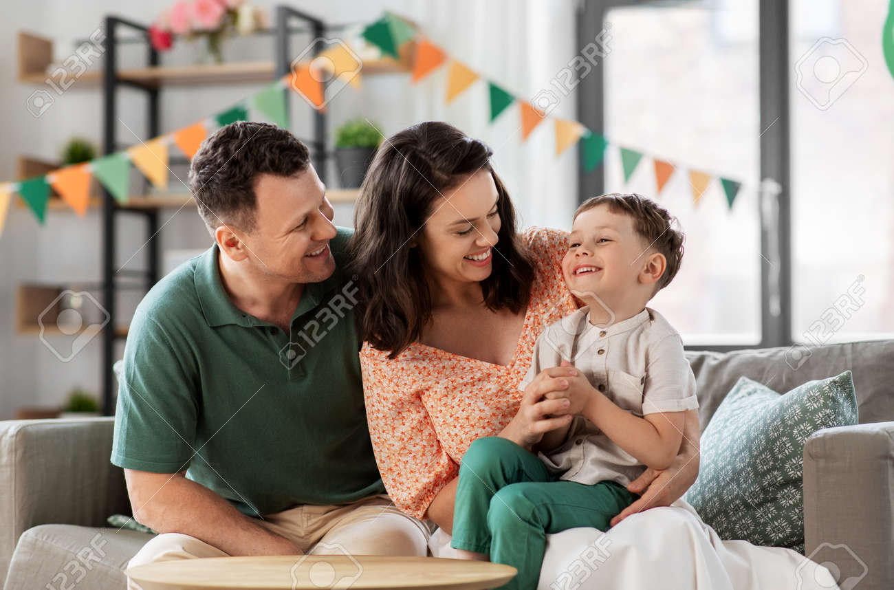happy family with little son at birthday party - 169966262
