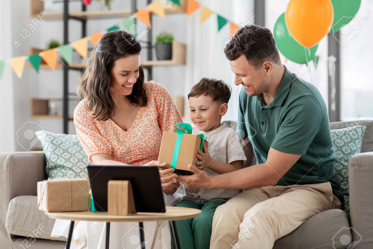 happy family giving present to little son at home - 169968141